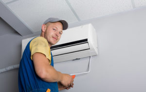 technician installing ductless ac